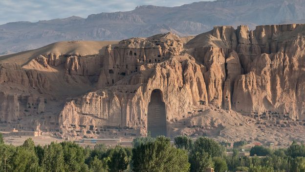 Today, all that remains of the two 6th-Century AD Buddha statues once carved into the Bamiyan cliff is an empty cavity (Credit: Credit: picassos/Getty Images)