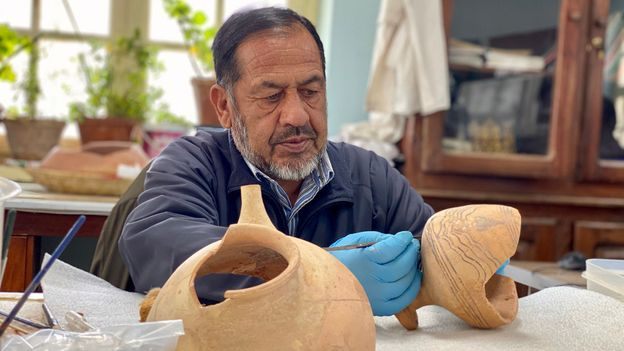 Shirzuddin Saifi is one of the conservators working to piece back together the 2,500-year-old artefacts the Taliban shattered (Credit: Credit: Hikmat Noori)
