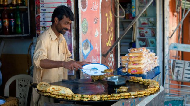 Bun-kebabs are one of Pakistan's most popular street foods and are sold from pushcarts and kiosks across the nation (Credit: Credit: dbimages/Alamy)