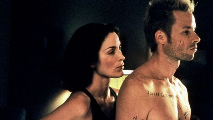 Several of Nolan's films – including Memento, which starred Guy Pearce and Carrie-Anne Moss – depend on wholly cinematic techniques (Credit: Alamy)