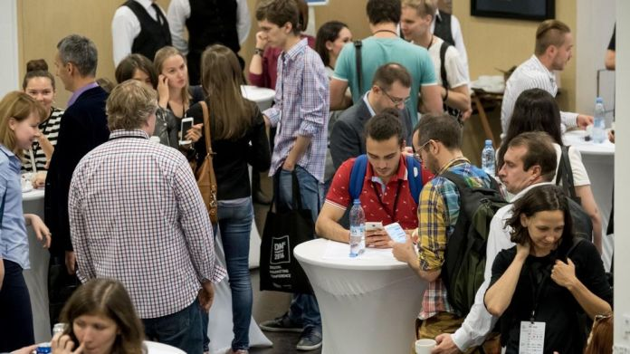 The main draw of conferences isn't always the speakers; networking and casual interactions are also valuable to participants
