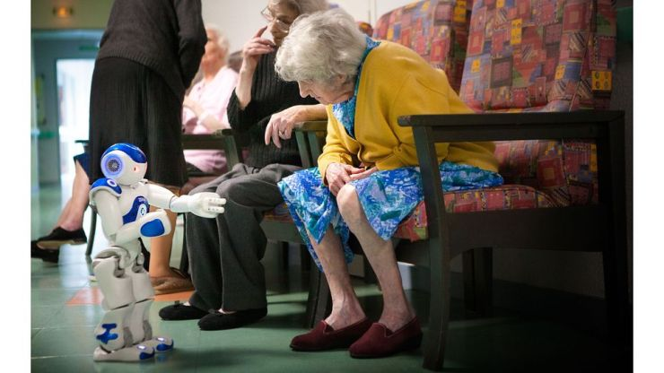 A variety of new technologies – including robots – have been developed to help people age well (Credit: Getty Images)