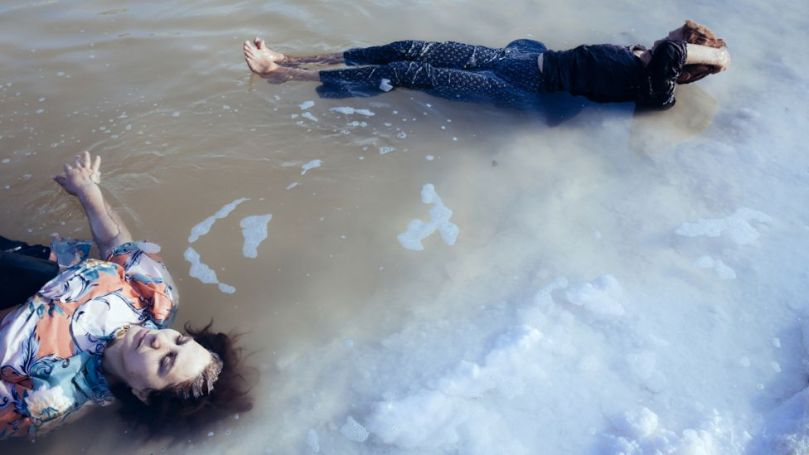 Women bathe in a remant of the lake in 2014, in a remote region of Lake Urmia that now receives few visitors (Credit: Solmaz Daryani)