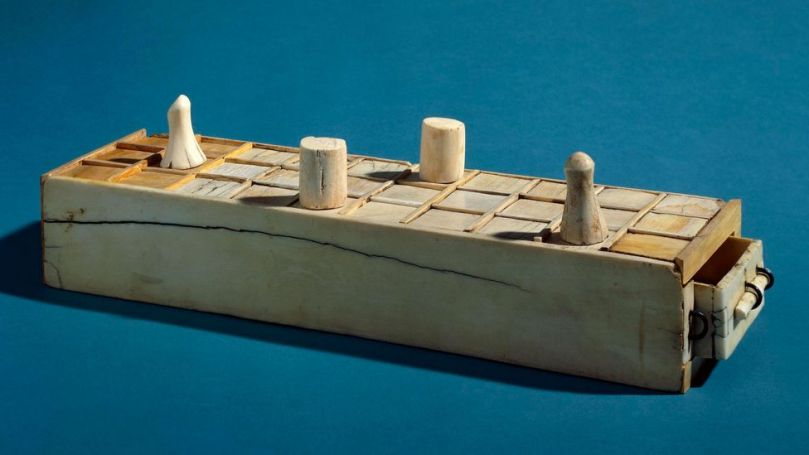 This Egyptian game box from 1400-1200BC has a senet board on top and 20 squares board underneath (Credit: The Trustees of the British Museum/ CC BY-NC-SA 4.0)