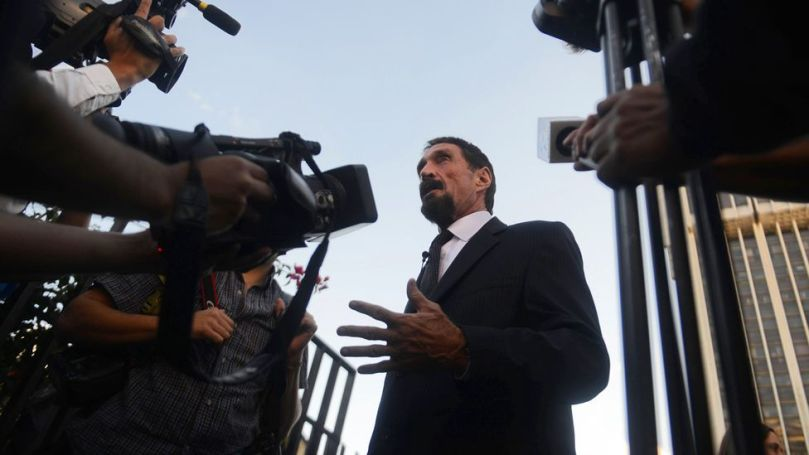 John McAfee speaks to journalists at the Supreme Court in Guatemala, after his location was revealed by a photo (Credit: Johan Ordonez/Getty Images)