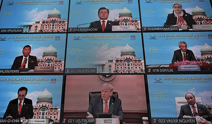 Trump attended the APEC online meeting but refused to use the official video background