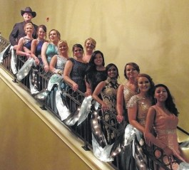 prom attendees pose along banister