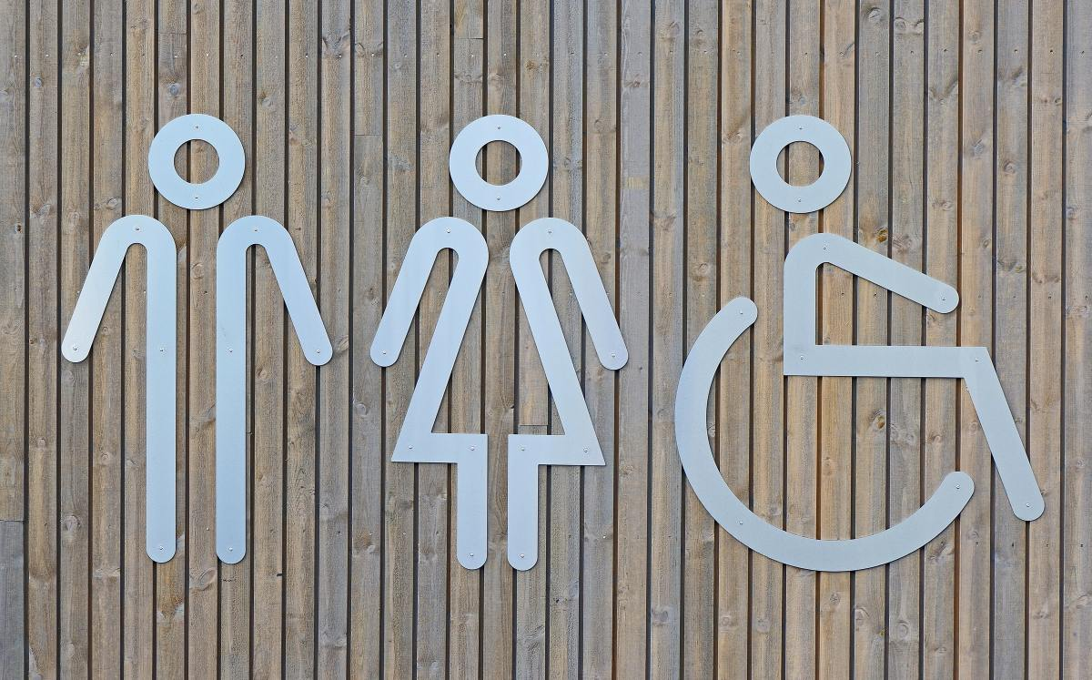 Three symbols for people, representing 'male', 'female' and 'wheelchair user'