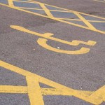 An empty Blue Badge parking space shows the yellow wheelchair icon associated with disability