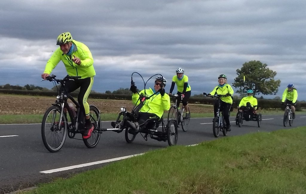 A group of cyclists using a variety of cycles