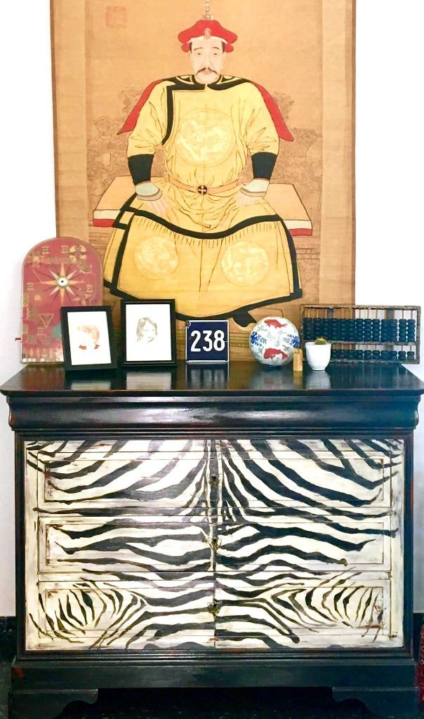 Chinese Emperor sitting on a zebra!