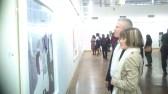 Dudziro Exhibition's attendees enjoying Zvavahera's artwork.
