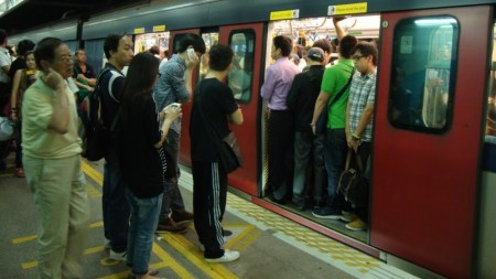 Hong Kong's former KCR lines (now owned by MTR) do not all have platform door barriers yet, but still have painted queues for boarding efficiency.
