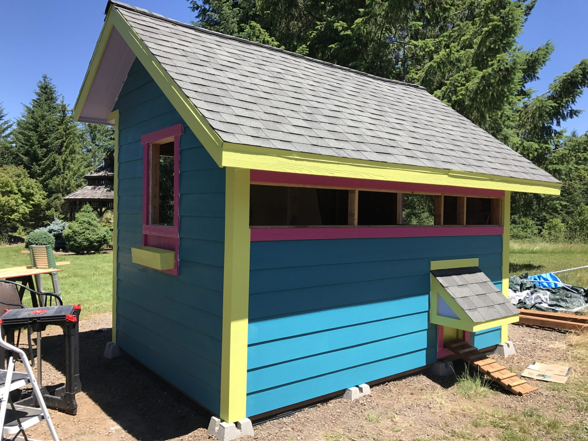 Chicken coop painting siding & installing windows – Yellow Cottage