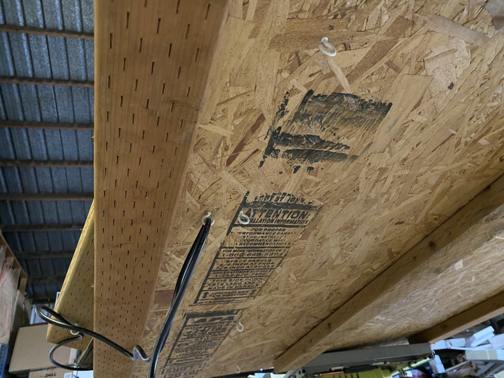 2x4s and hooks underneath