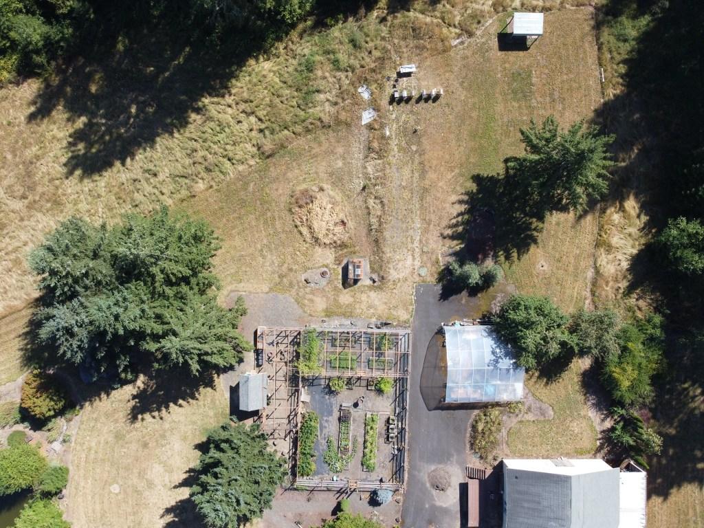 Beehives, veggie garden, hoop house