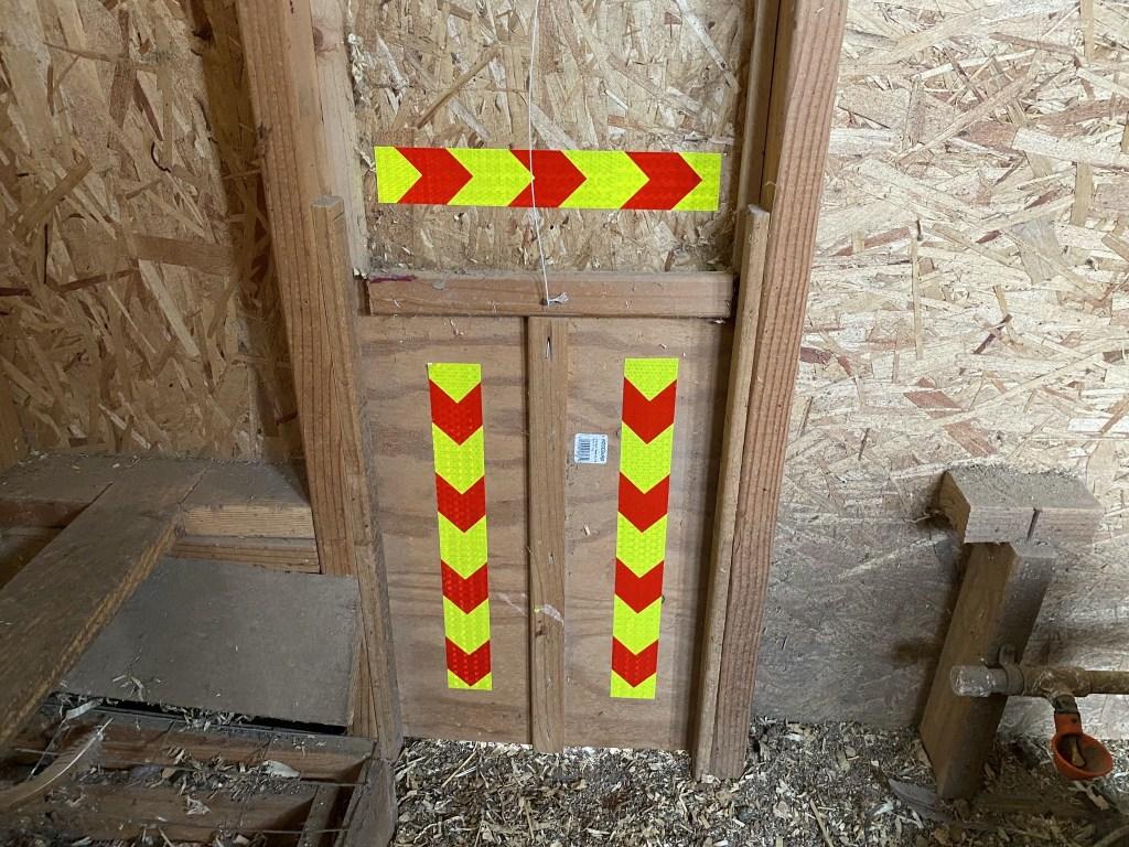 Reflective tape on pop door