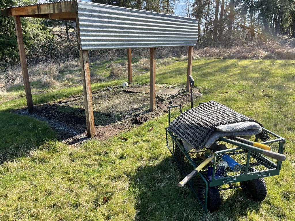 Old potting shelter and cart of materials and tools