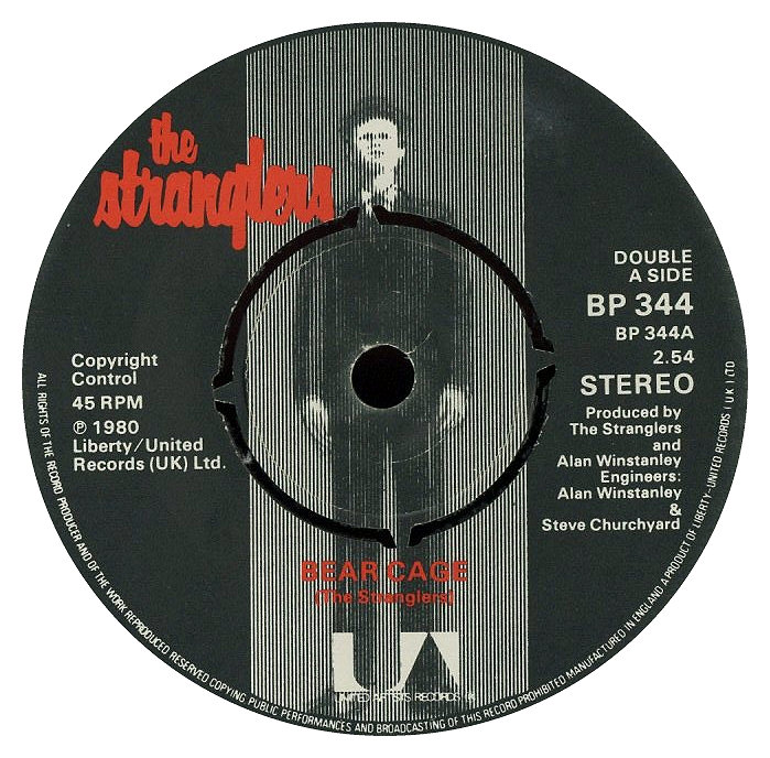 man in hat dressed on black suit on the record label