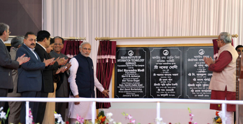 The Prime Minister, Mr. Narendra Modi unveiling the plaque of foundation stone of the new campus of IIIT Guwahati, in Assam on January 19, 2016. The Chief Minister of Assam, Mr. Tarun Gogoi and other dignitaries are also seen.
