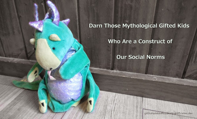 Darn Those Gifted Kids Who are a Contruct of Our Social Norms, yellowreadis.com Image: Toy dragon looking sadly at floor against wooden wall