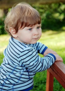 Image: small child in striped shirt