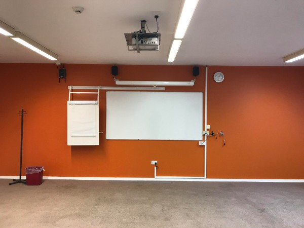 View of recently repaint wall with whiteboard and digital projector