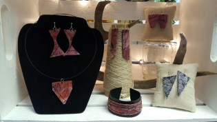 A selection of naturally dyed and machine embroidered jewelery