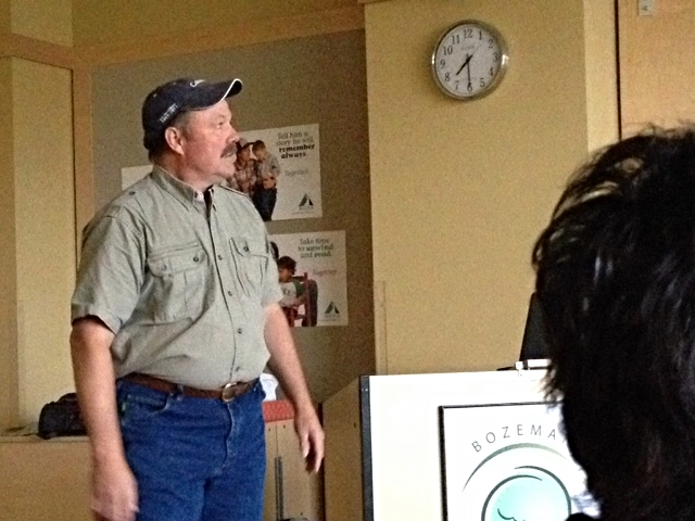 Dr. Tom Smith talks to a group in Bozeman, Montana about safety in bear country