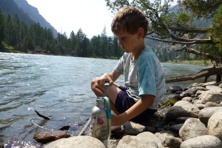 boy filtering water