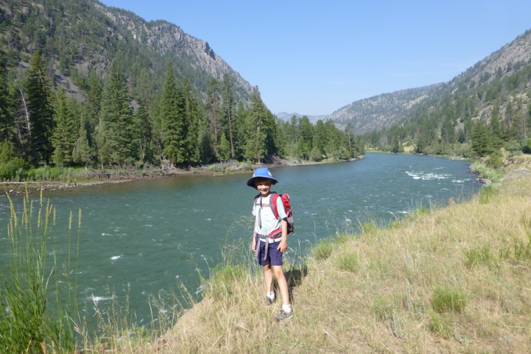 Anders standing next to yellowstone river