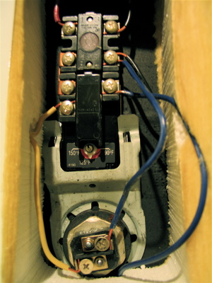 Electric hot water heater - upper thermostat