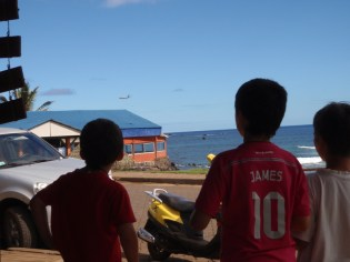 Kids watch the daily afternoon flight come in