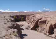 The gorge of Toconao - typical of numerous running down into Salar from the hills around