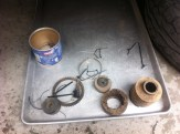 The worn parts are collected neatly on an examination tray!