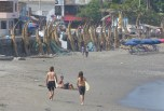 The local surfers resort beach of Huanchaco where tourists can try the traditional reed fishing boats, which are still used by fishermen in some places along the coast