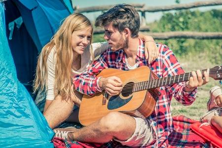 47114334-couple-in-a-camping-site-playing-guitar-and-singing-lovers-on-a-wekk-end-vacation-in-the-nature.jpg