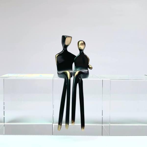 caress bronze couple