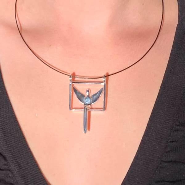 Model wearing Angel pendant in silver