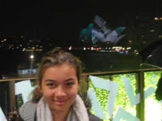 Ciara and the Opera House lit up.
