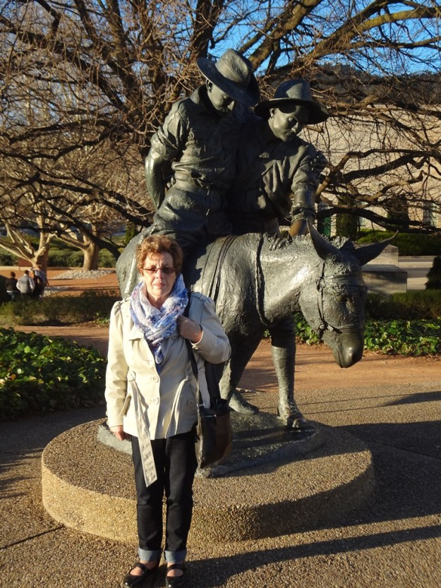 Mum at the sculpture of Simpson and his donkey.