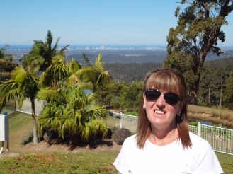 Gail at agle Heights Resort, with Surfers Paradise behind her.