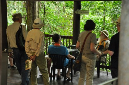 Group of visitors listening to the bird man.