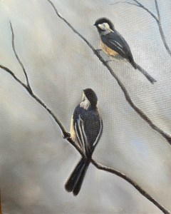 Two chickadees on a gray day