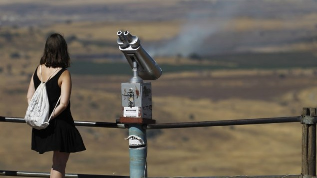 IDF says stray fire from Syria hits UN position in Golan Heights