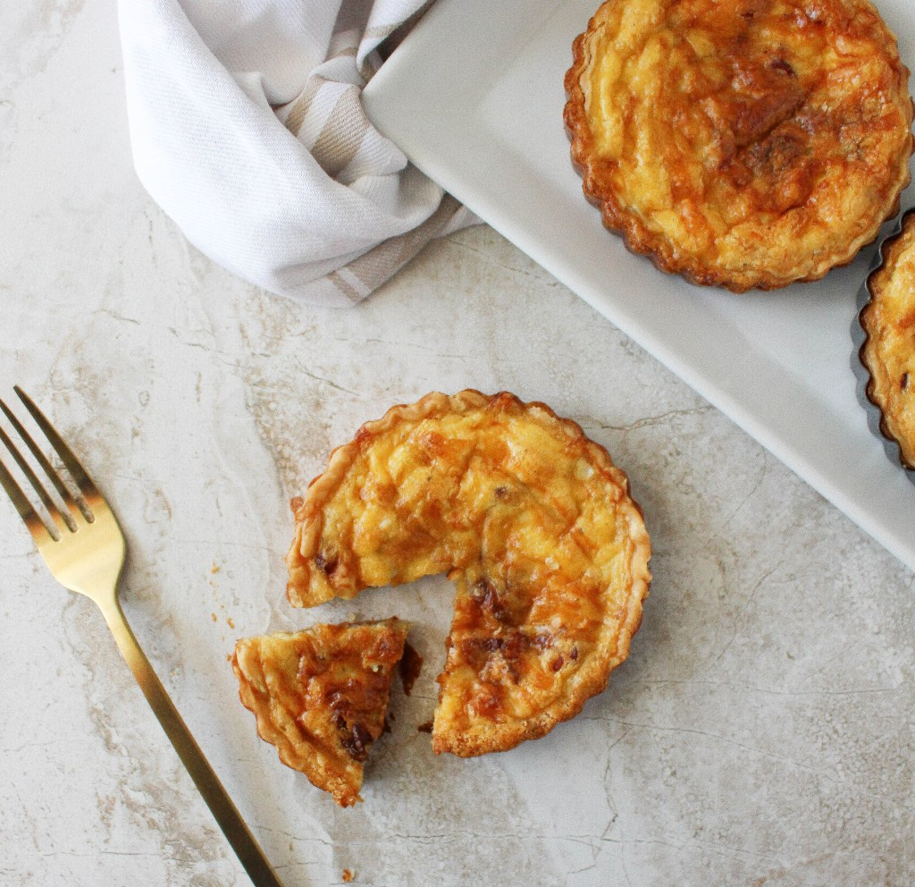 Mini Quiches with Caramelized Onions, Gruyere, & Bacon | Yes to Yolks