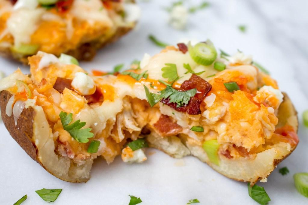 Loaded Buffalo Chicken Baked Potatoes | yestoyolks.com
