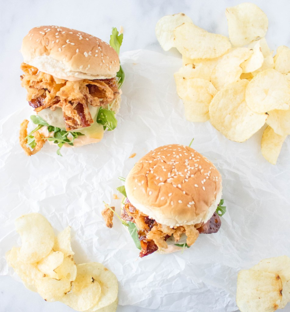 Cheeseburgers with Stout-Glazed Bacon, Crispy Onions, & Sriracha Aioli | yestoyolks.com