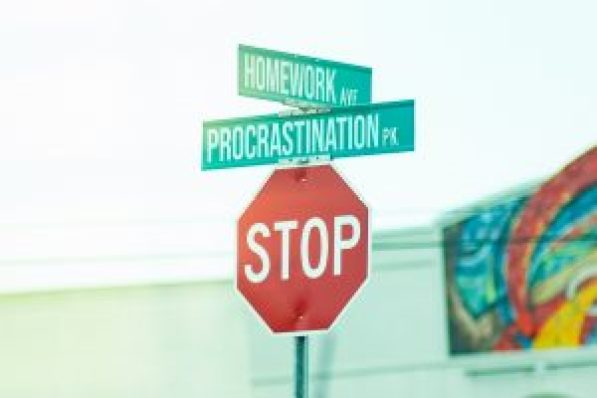 How to conquer procrastination with 2 minute rule depicted by a Stop Procrastination signage