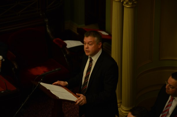 Minister for Youth Affairs, Ryan Smith, addressing Youth Parliament. Photo - Finbar O'Mallon